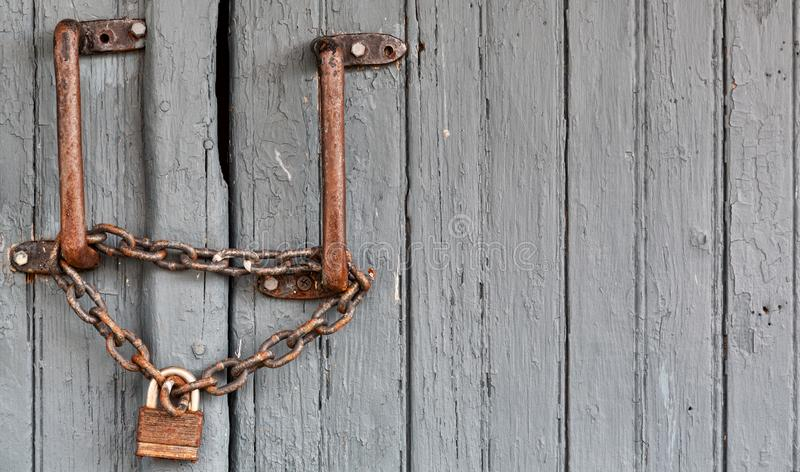 Very old lock on a wood door royalty free stock photos