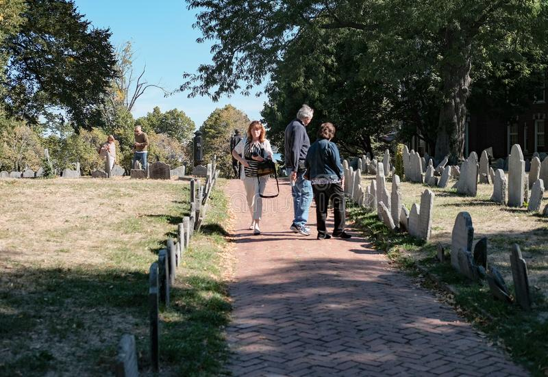 Members of the US public seen looking a old war graves in a Boston cemetery. stock images