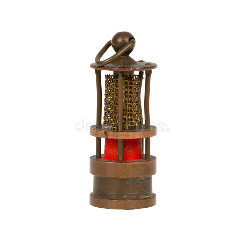 Very old miniature of a miners lamp stock photo