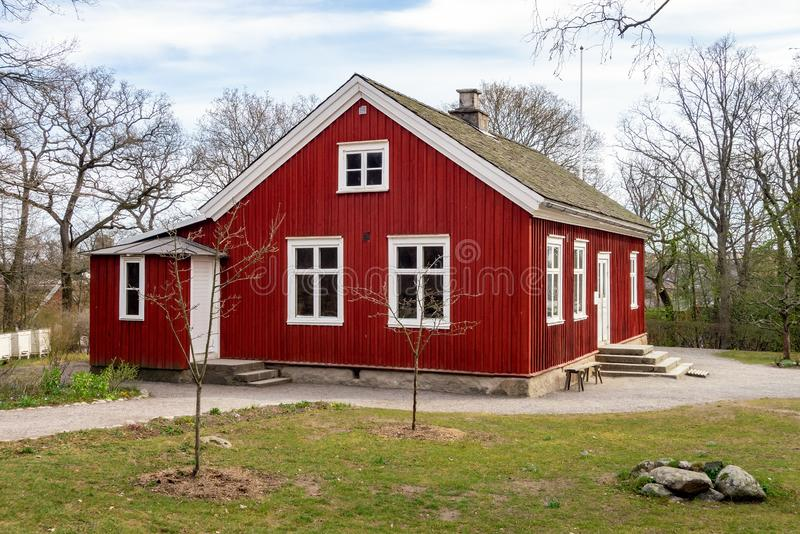 Very old red building of a historical school in Skansen open aur museum in Stockholm, Sweden. Europe royalty free stock photo