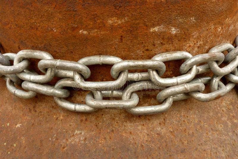 A very old rustic rusted metal surface and chains stock photo