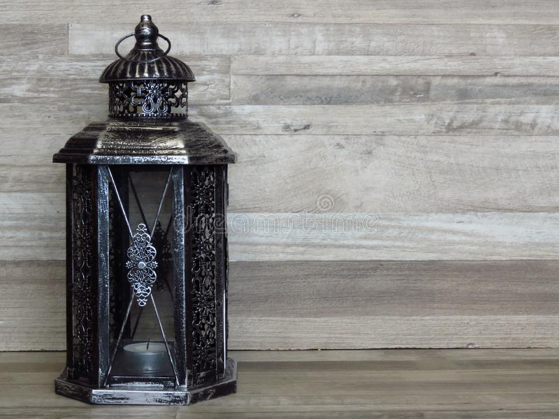 A very old silver lantern. Rustic, retro style. Handicrafts, craftsmanship, light, old house lighting concept. royalty free stock photo