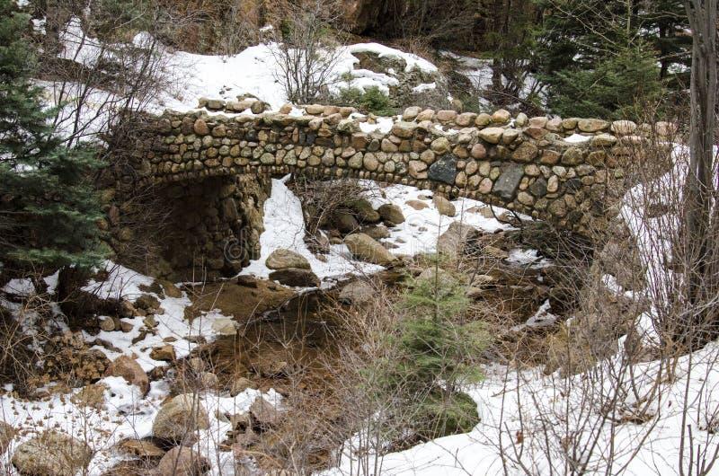 Very Old Stone Bridge. Stone bridge crossing a small stream area . Located in Cheyenne Mountain Colorado area in the winter time stock photos
