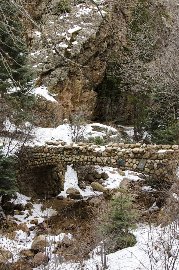 Very Old Stone Bridge. Stone bridge crossing a small stream area . Located in Cheyenne Mountain Colorado area in the winter time royalty free stock image