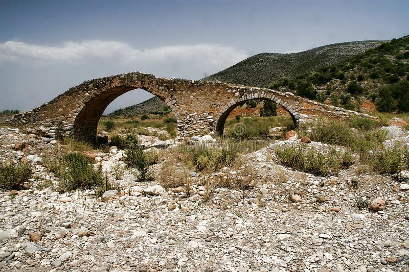 Very old stone bridge, Greece stock images