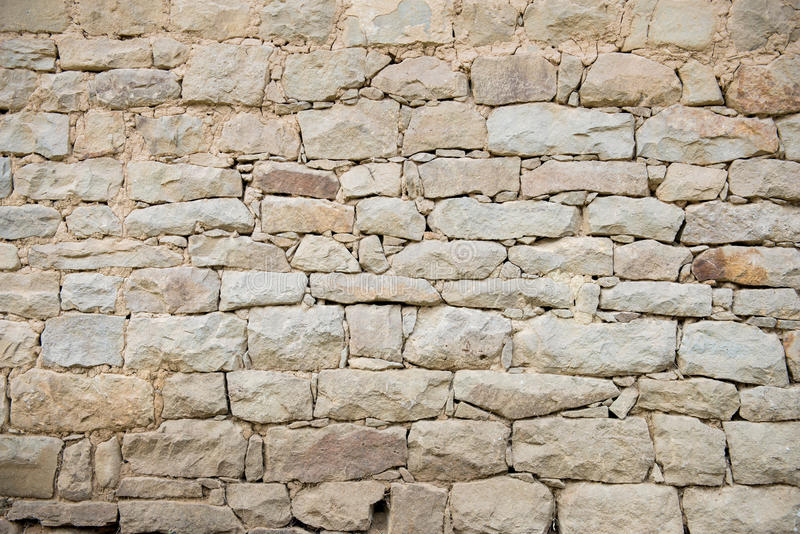 Very old stone wall perfectly as backround. Old house fence stock photo