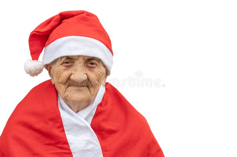 Very old woman 90 years old Mrs Claus with funny expression. Grand-mother or elderly woman with big happy smile wearing Santa. Claus hat perfect for Christmas royalty free stock images