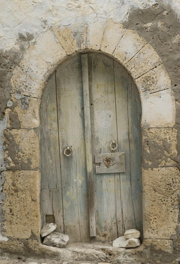 Very old wooden arc door in arabian style royalty free stock image