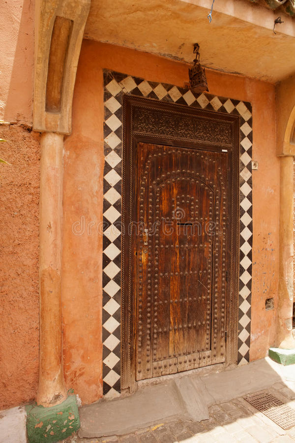 Very old wooden door into the house, Morocco royalty free stock image