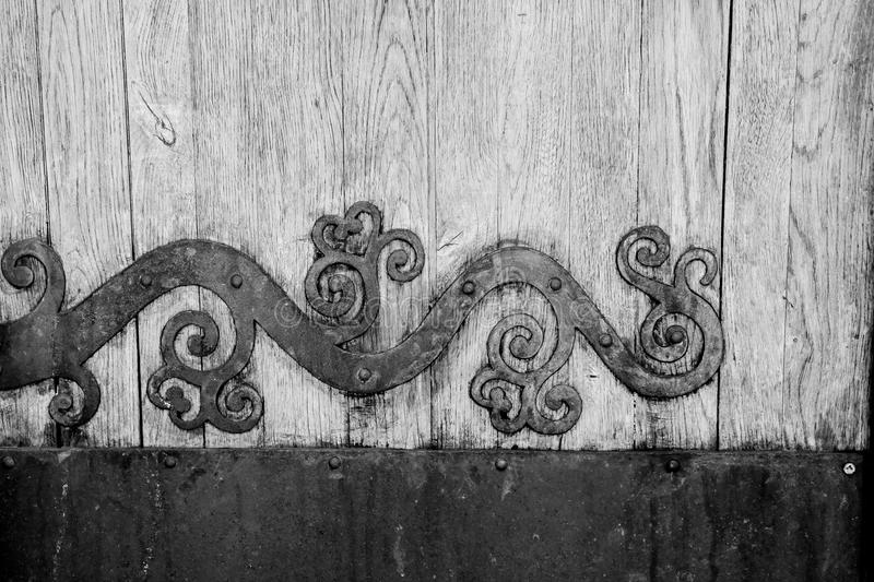 Door with metal ornaments. Very old wooden door with ornaments stock photo