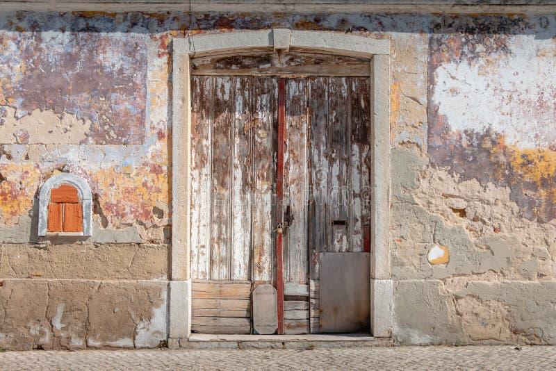 Very old worn wooden door with peeling paint stock photo