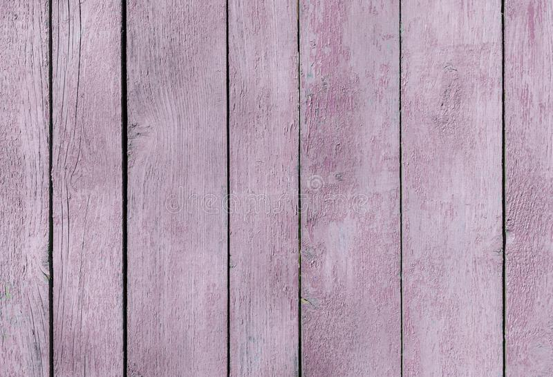 Very pale purple old wooden fence. wood palisade background. planks texture, weathered surface stock images