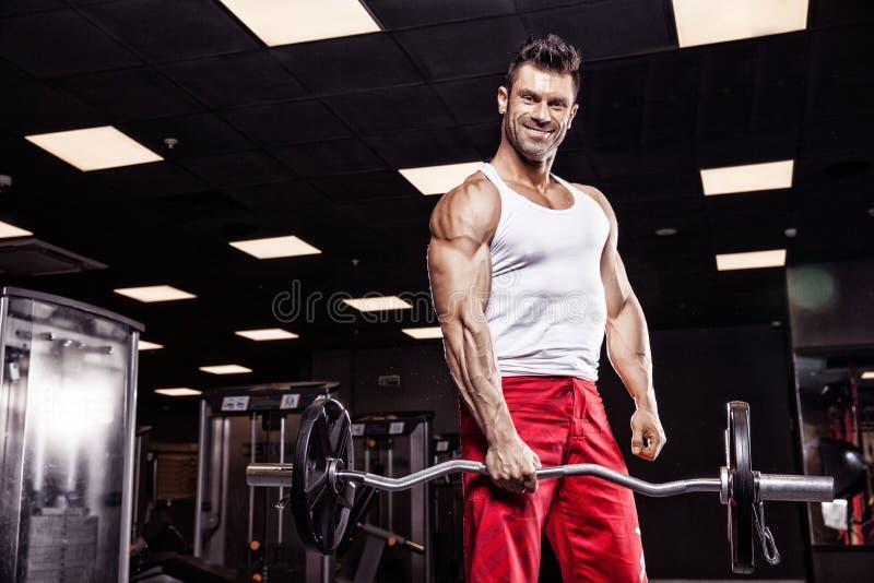 Very power athletic guy bodybuilder royalty free stock image
