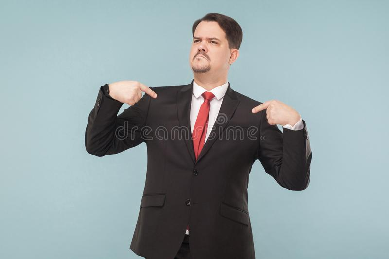 A very proud man shows his fingers and boasts stock photo