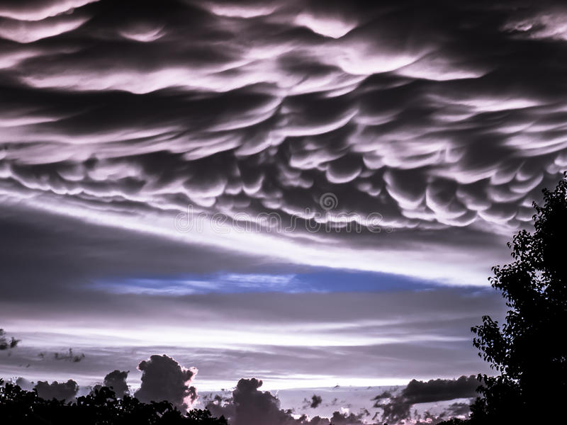 Very rare Mammatus clouds with cumulonimbus in near sunset royalty free stock image
