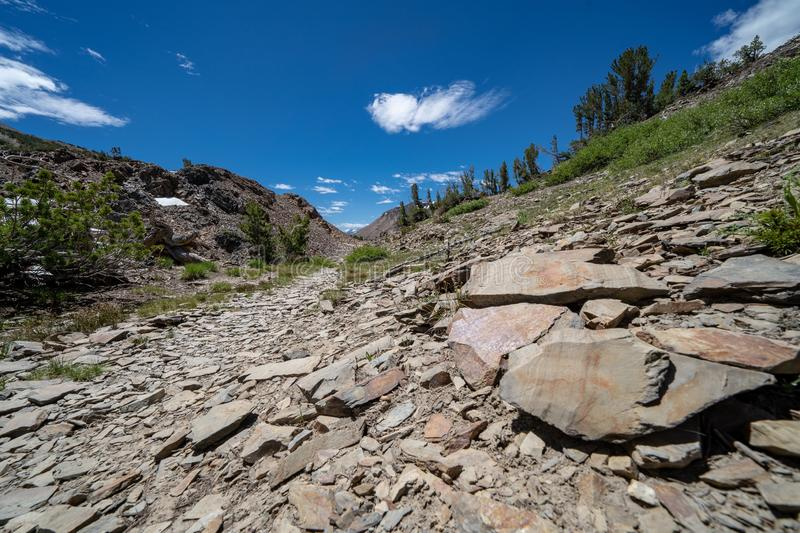 Very rocky trail of scree and talus rocks along the 20 Lakes Basin California royalty free stock photos