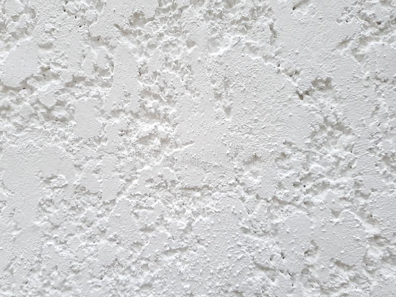 Very rough concrete texture, white painted wall background stock image