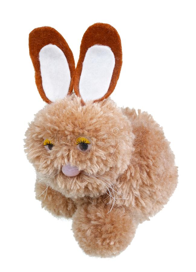 A very sad homemade Easter bunny made of woolen threads isolated stock images