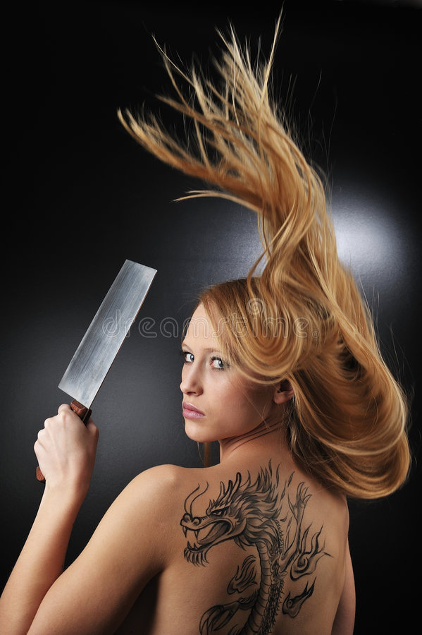 Very dragon tatoo girl. Very dragon tatoo blond girl stock photos
