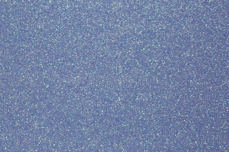 Shimmering glittery background in light blue color stock photo