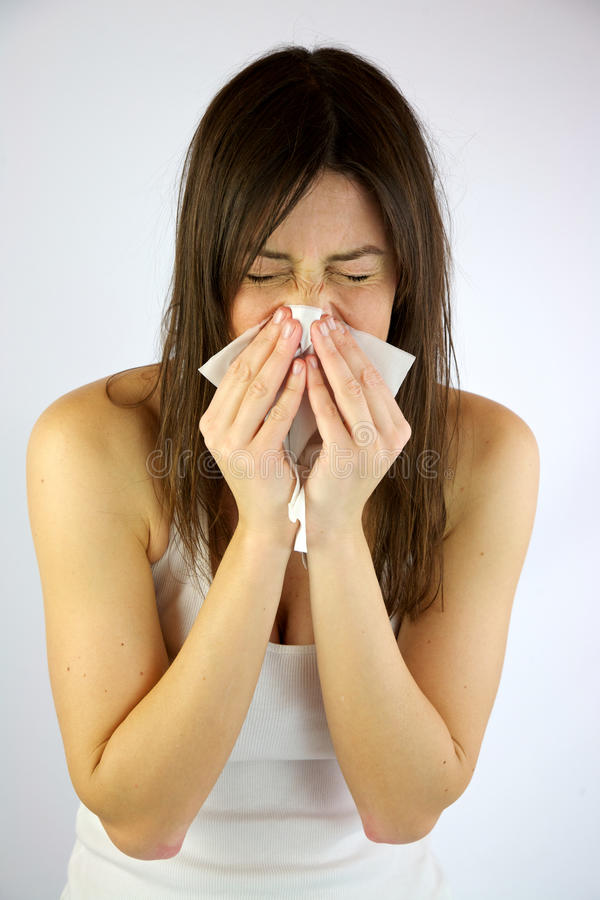 Very sick girl sneezing royalty free stock images