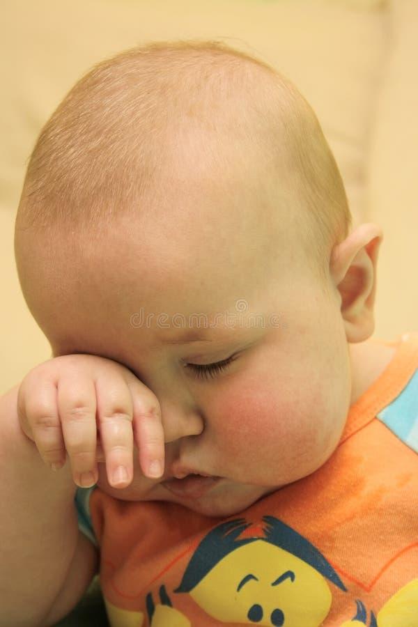 Very sleepy baby royalty free stock photography