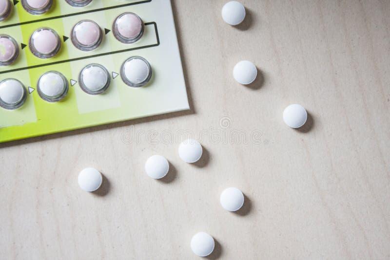 Very small white round pills stock image
