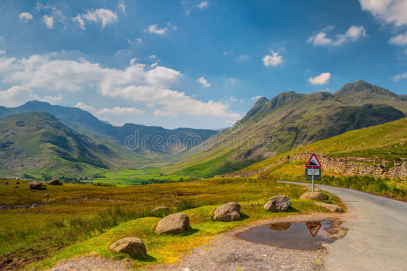 Very steep road in Great Langdale valley. In England - HDR Image stock photo