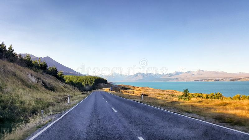 Straight scenic road in New Zealand. royalty free stock images