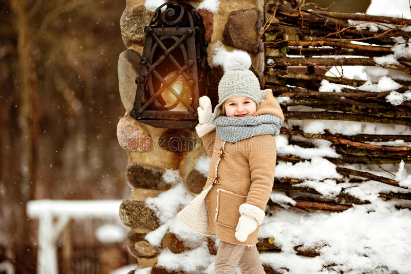 Very sweet beautiful little girl child in a beige coat defiantly royalty free stock image