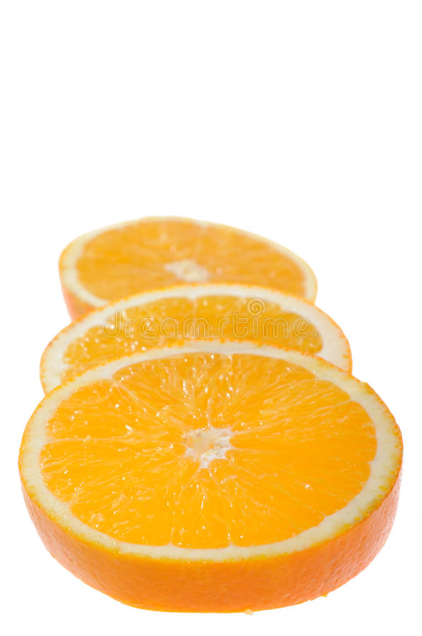 Very tasty orange. Juicy orange slices in very tasty view on white background. Focus on midd󠯦 first slice. Shallow DoF stock image
