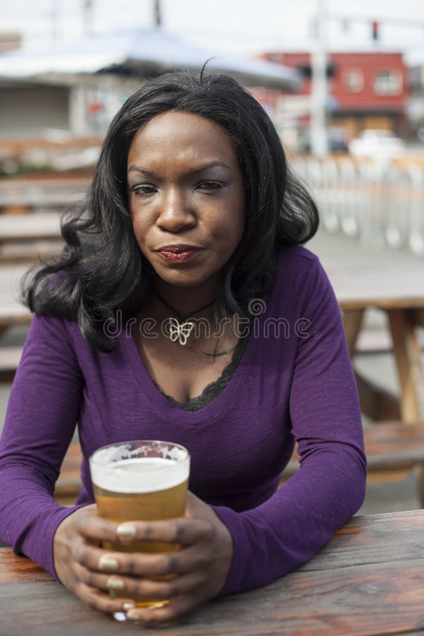 Download Angry Young African American Woman Drinks Pint Of Pale Ale Stock Photo - Image: 30165648
