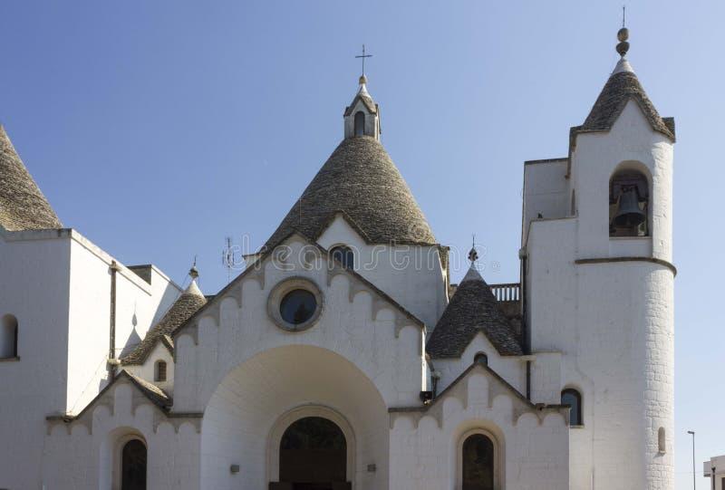 The very unique trullo church of Alberobello, Italy royalty free stock photos