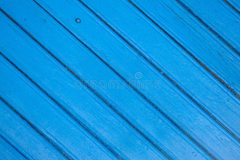 Verzadigde blauwe houten planking achtergrond met barsten royalty-vrije stock foto