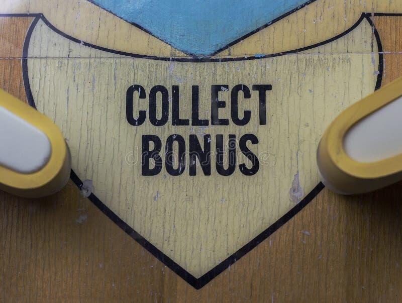 Verzamel Bonusembleem op een Flipperkast royalty-vrije stock afbeeldingen