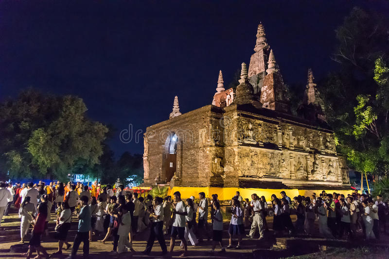 Vesak Day. CHIANG MAI, THAILAND - JUN 01: Clergy and Buddhists candle lit around mock bodh gaya pagoda in Vesak Day at Jed Yod temple on June 01, 2015 in Chiang royalty free stock images