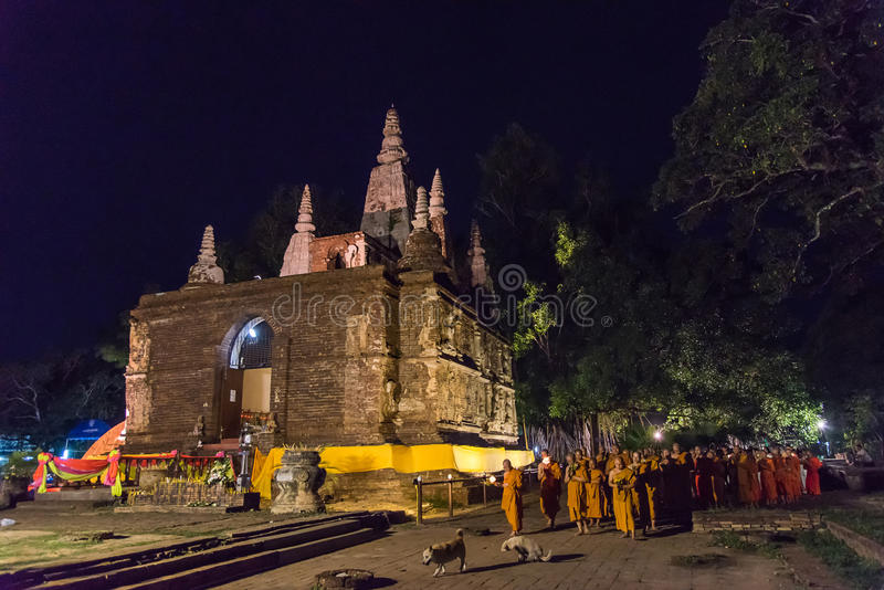 Vesak Day. CHIANG MAI, THAILAND - JUN 01: Clergy and Buddhists candle lit around mock bodh gaya pagoda in Vesak Day at Jed Yod temple on June 01, 2015 in Chiang stock images