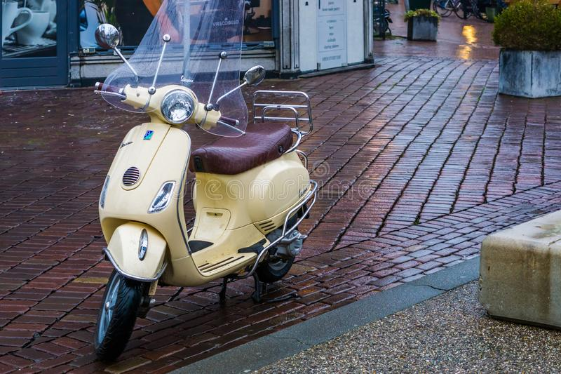 Vespa scooter parked in the city streets, popular urban transport, well known brand from italy, Alphen aan den rijn, 12 februari, stock photos