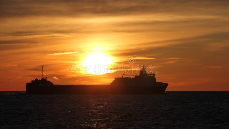 Vessel in the sea against the backdrop of a beautiful sunset. Copy space. Seascape. Sunset stock photos