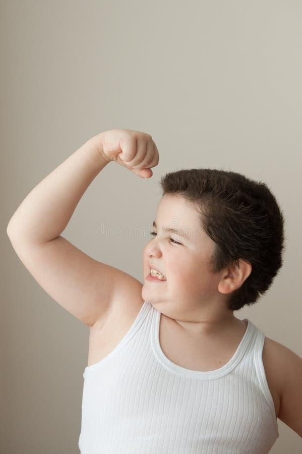 Veste gorda do exercício poderoso grosso do esporte do músculo do treinamento da força da criança do menino fotografia de stock