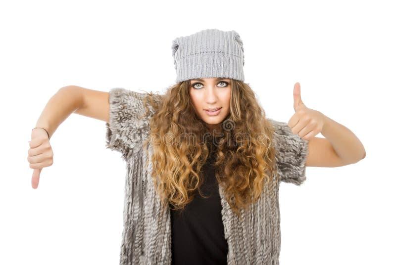 Vestido del invierno para una muchacha que manosea con los dedos fotografía de archivo libre de regalías