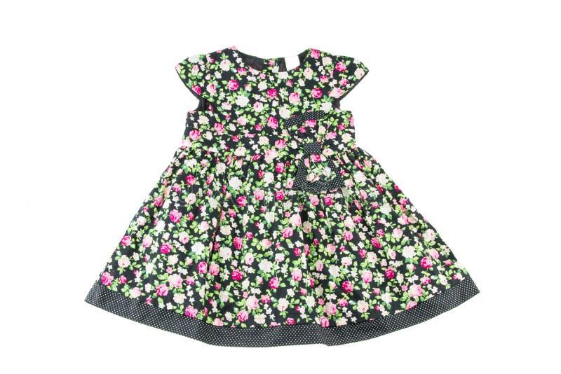 Vestido elegante da menina A beleza e o estilo no ` s das crianças vestem-se Isolado no fundo branco imagens de stock royalty free