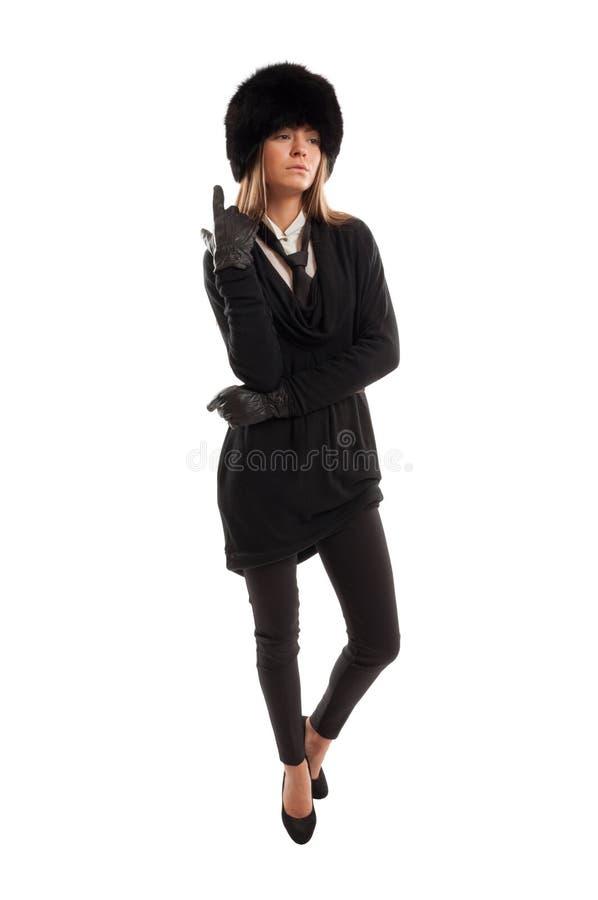 Vestido femenino en negro en el fondo blanco foto de archivo