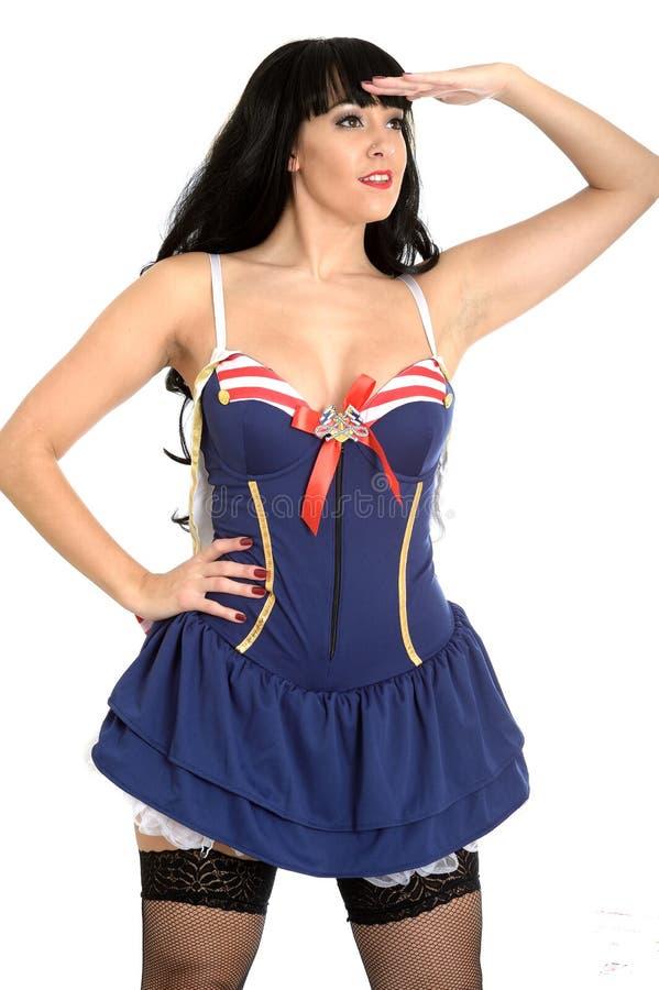 Vestido 'sexy' de Pin Up Model Wearing Sailors com as meias da rede dos peixes fotos de stock