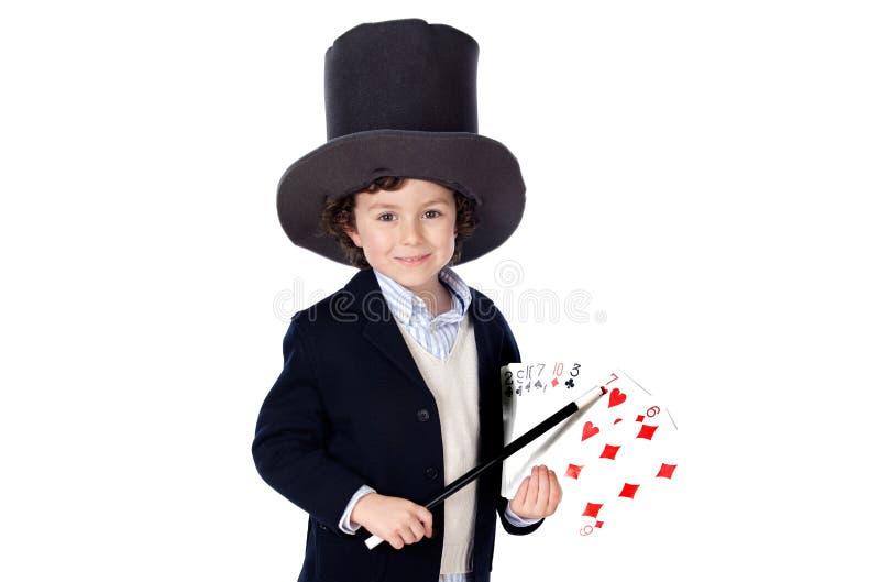 Vestito adorabile dal bambino del illusionist con il cappello immagini stock