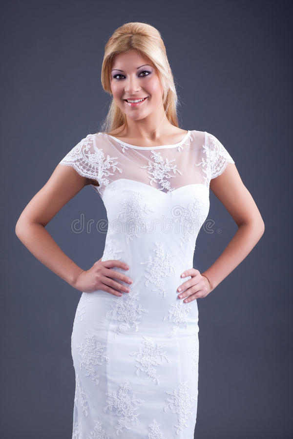 Vestito bianco da portare dalla donna sexy fotografia stock