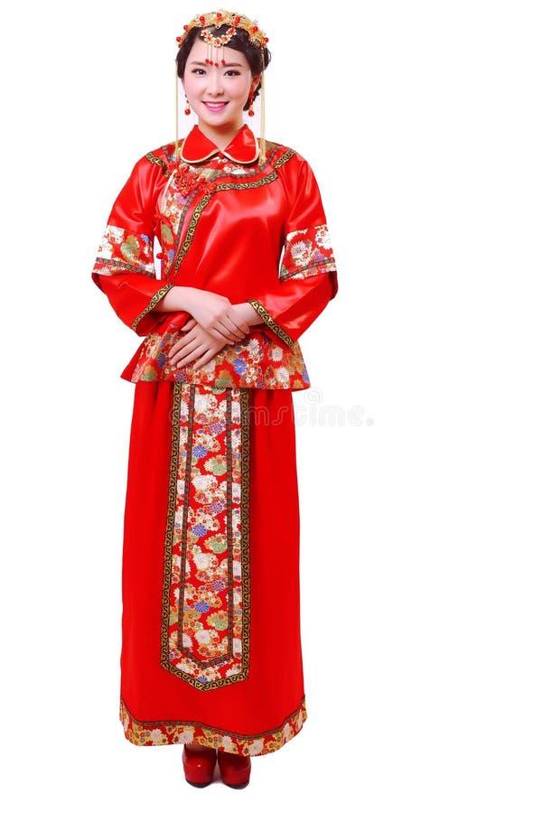 Vestito da sposa cinese e una bella sposa fotografie stock