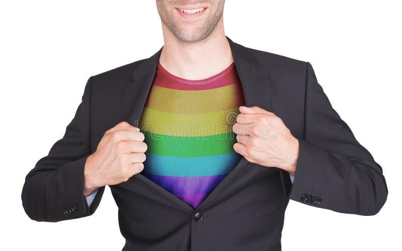 Vestito di apertura dell'uomo d'affari per rivelare camicia con la bandiera immagine stock libera da diritti