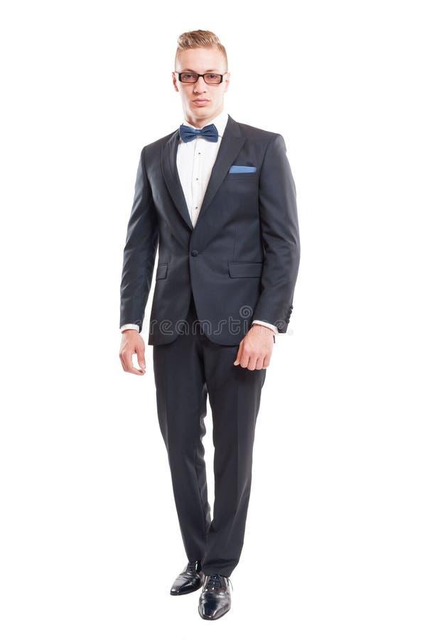 Vestito e cravatta a farfalla d'uso di modello maschii eleganti fotografia stock