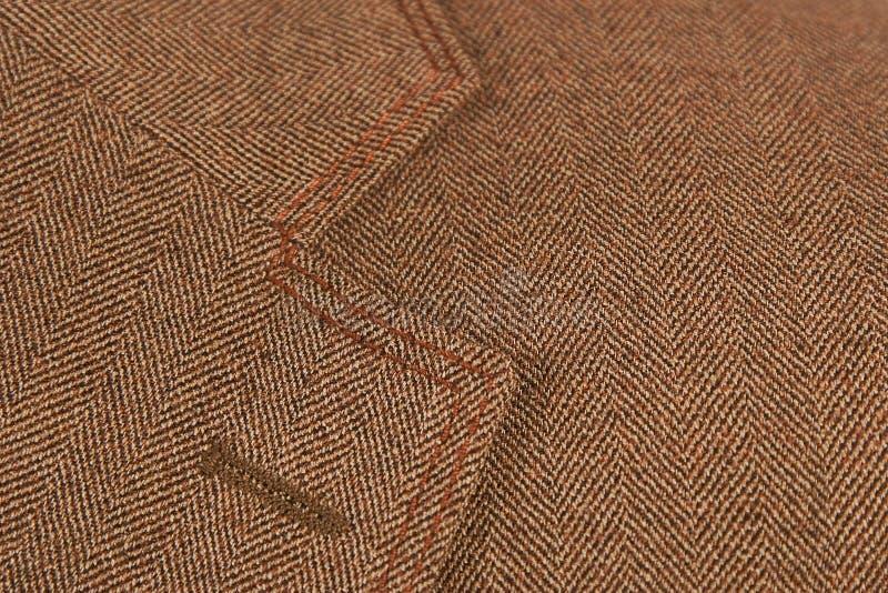 Vestito elegante dell'occhiello del Brown fotografia stock libera da diritti